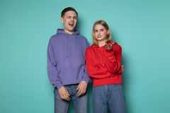 Young beautiful couple man and woman in casual clothes with surprise and shocked facial expression stock photography