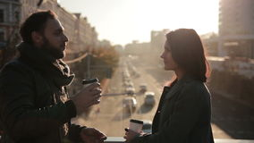 Young beautiful couple met at the city bridge. On the Sunset stock video footage