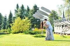 Young beautiful couple near big ship in a garden Royalty Free Stock Image