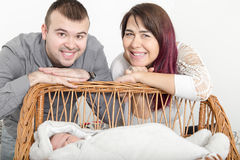 Young Beautiful Couple with New Baby at Home stock photos