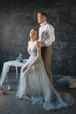 Young beautiful couple of newlyweds in decorated studio Royalty Free Stock Images
