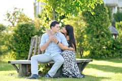 Young beautiful couple in a park. Young beautiful couple sitting in a park Royalty Free Stock Image