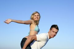 Young beautiful couple playing on the beach Royalty Free Stock Photo
