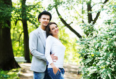 Young beautiful couple posing in the park Royalty Free Stock Photos
