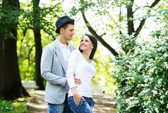 Young beautiful couple posing in the park Royalty Free Stock Photo