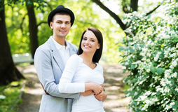 Young beautiful couple posing in the park Stock Image