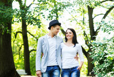 Young beautiful couple posing in the park Royalty Free Stock Images