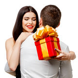 Young beautiful couple with present isolated on white Royalty Free Stock Photo