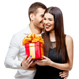 Young beautiful couple with present isolated on white Royalty Free Stock Images