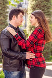 Young beautiful couple relaxing outdoors Royalty Free Stock Image