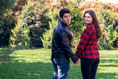 Young beautiful couple relaxing outdoors Royalty Free Stock Images