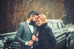Young beautiful couple relaxing together walking at a retro car. Young beautiful couple relaxing together walking at a retro car stock photo