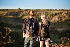 Young beautiful couple resting, enjoying view in canyon. Royalty Free Stock Photo