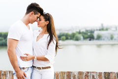 Young beautiful couple rubbing noses as a sign of love. And about to kiss each other Royalty Free Stock Image