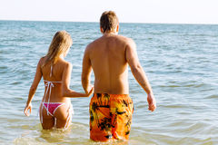 Young beautiful couple at the seaside Stock Images