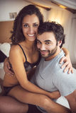 Young beautiful couple in sensual games in bed Stock Image