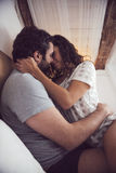 Young beautiful couple in sensual games in bed Stock Images