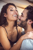 Young beautiful couple in sensual games in bed Royalty Free Stock Photo