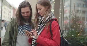 Young beautiful couple share memories and pictures on social media with online mobile app. stock footage