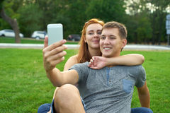Young beautiful couple shooting self portrait Stock Photos