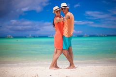 Young beautiful couple showing thumbs up on the. Beach. This image has attached release Royalty Free Stock Image