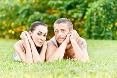 Young beautiful couple sits on Stock Images