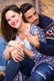 Young beautiful couple sitting on train tracks Royalty Free Stock Images