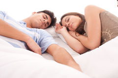 Young beautiful couple sleeping. Lovely couple sleeping together in bed stock images