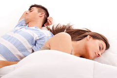 Young beautiful couple sleeping. Lovely couple sleeping together in bed stock photo