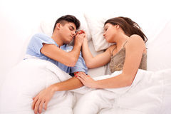 Young beautiful couple sleeping. Lovely couple sleeping together in bed stock image
