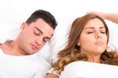 Young beautiful couple sleeping in bed Stock Photography