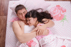 Young beautiful couple sleeping in bed Stock Images