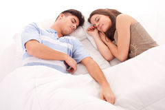 Young beautiful couple sleeping together in bed Stock Photo