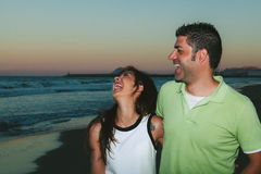Young Beautiful Couple Smiling On the Beach Royalty Free Stock Images