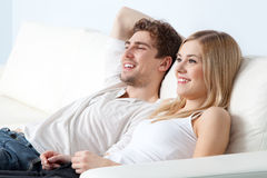 Young beautiful couple on a sofa at home Royalty Free Stock Photography