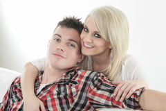 Young beautiful couple on a sofa at home Royalty Free Stock Images