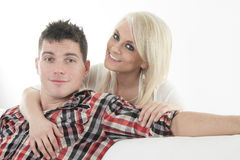 Young beautiful couple on a sofa at home Royalty Free Stock Photos