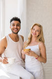 Young Beautiful Couple Stand Near Big Window, Drink Morning Coffee Cup, Happy Smile Hispanic Man Woman Royalty Free Stock Photography
