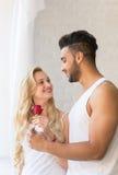 Young Beautiful Couple Stand Near Big Window, Hispanic Man Give Woman Red Rose Royalty Free Stock Photo