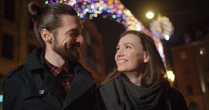 Beautiful young couple on a night date. Young beautiful couple standing on city street at night, portrait Stock Images