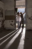 Young beautiful couple standing in doorway with backlighting Royalty Free Stock Photography