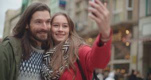 Young beautiful couple taking selfie in a city. stock video footage