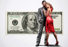 Young beautiful couple under money Stock Images