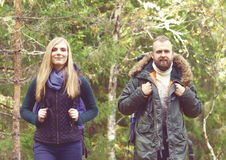 Young beautiful couple walking in forest. Camp, tourism, hiking Royalty Free Stock Photography