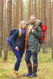 Young beautiful couple walking in forest. Camp, tourism, hiking. Concept Royalty Free Stock Photo