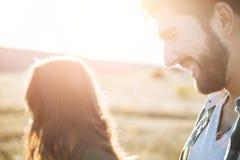 Young beautiful couple walking outside on beautiful sunset. royalty free stock photos