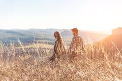 Young beautiful couple walking outside on beautiful sunset. stock photo