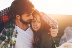 Young beautiful couple walking outside on beautiful sunset. royalty free stock images