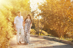 Young beautiful couple walking in a summer park Royalty Free Stock Photo