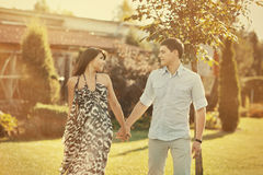 Young beautiful couple walking in a summer park Stock Photo